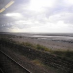 Looking through the train window along the west Cumbrian coast towards St. Bee's Head.